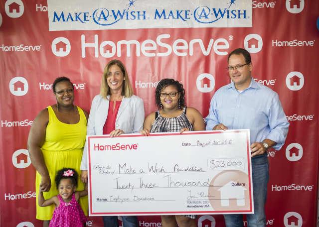 Ms. Lashawnda Cantey, daughter Trinidad, 3; Maria Arnold, Make-A-Wish Connecticut Development Officer; Make-A-Wish recipient Ayasha Cantey; HomeServe USA CEO Tom Rusin