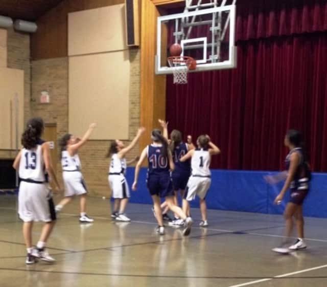 The Harvey girls basketball team, in blue, are 3-1 so far this season.