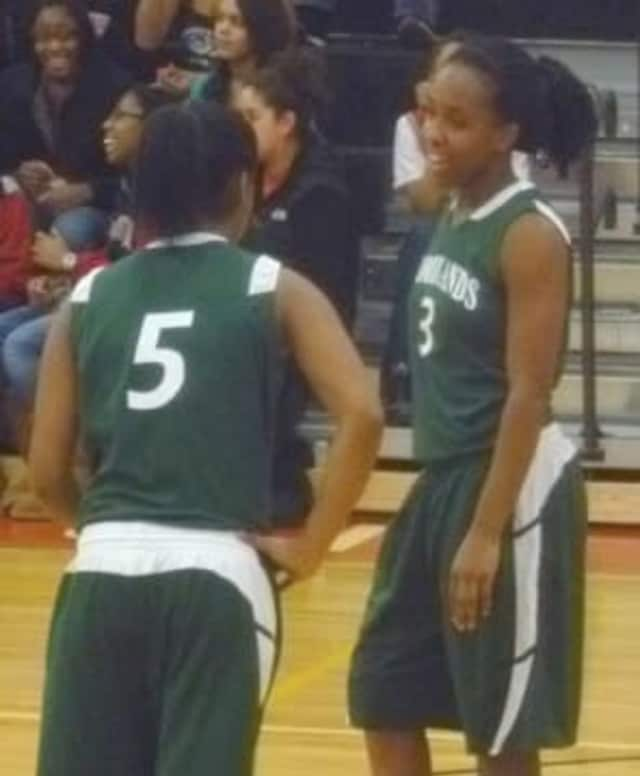 Imani Tilford, right, and the Woodlands High School Falcons lost to the Alexander Hamilton Red Raiders in last year's Elmsford Basketball classic. This year's tournament starts Thursday.