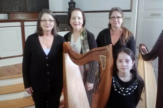 From left, Lois Colin, Maggie Skau, Karen Colin and Maggie Varenne of the Westchester Harp Ensemble perform at St. Paul's Historic Church in Mount Vernon on Wednesday.