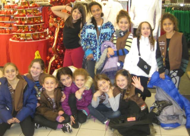 The girls of Rye Brook's Brownie Troop #1905 shop for clothing to supply Westchester Jewish Community Services' Kids Kloset.