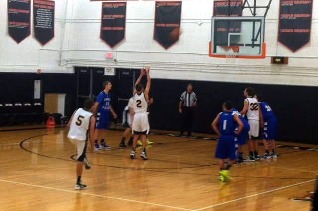 The Dobbs Ferry High School basketball team (in blue) lost to Hastings in the first round of the Croton tournament.