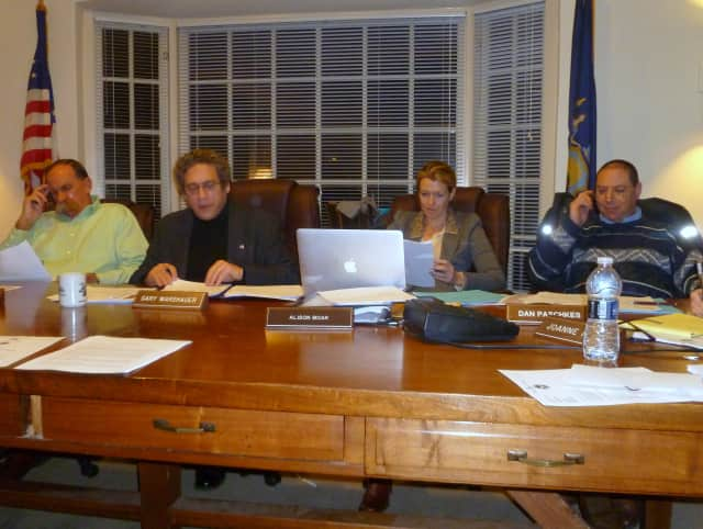 The Pound Ridge Town Board will hold a public hearing on a local law that will set up a loan program for commercial buildings to help make them more energy efficient. From left, Dick Lyman, Supervisor Gary Warshauer, Ali Boak and Dan Paschkes.