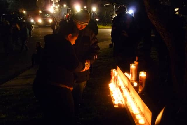 A candlelight vigil highlighting the hardships of Syrian refugees was conducted Saturday evening on Main Street in South Paterson.