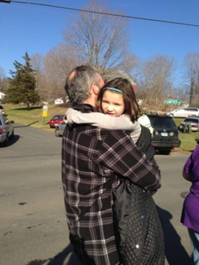 Parents and kids reunite outside the Sandy Hook School in Newtown, Conn.