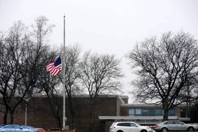 The flag outside of Westlake High School is hung at half-staff Monday following Friday's tragedy in Newtown, Conn.
