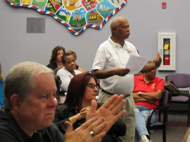 A Port Chester resident speaks up at a town hall-style meeting Sept. 27 about quality of life in Port Chester.