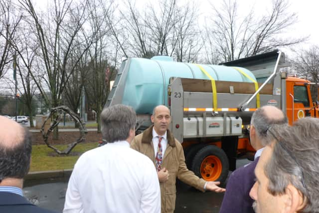 Greenburgh Department of Public Works Commissioner Victor Carosi shows the Town Board the new brine truck that will help in snow removal this winter.