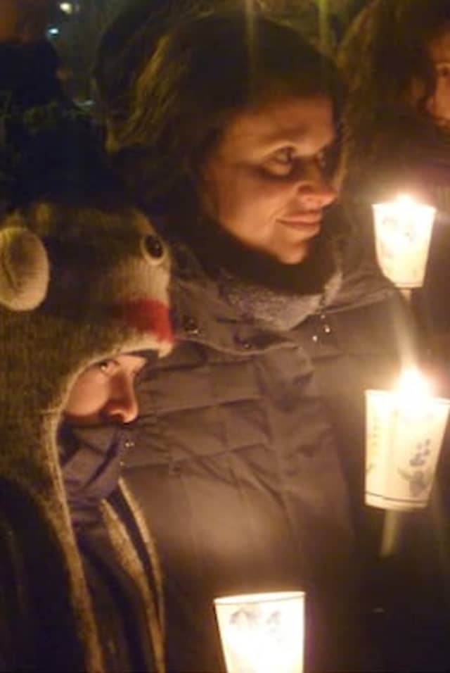 Candlelight vigils like this one in Dobbs Ferry on Sunday are continuing around the Greenburgh area to remember the victims of the Newtown school shooting.
