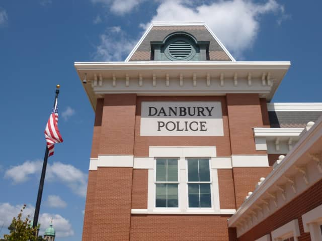 Danbury police arrested an area man for allegedly smashing another man in the face with a bottle.