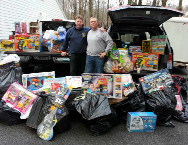 Pound Ridge PBA members Mike Armistead, left, and Gary Olivier take the first two loads of toys to the Toys for Tots collection location.