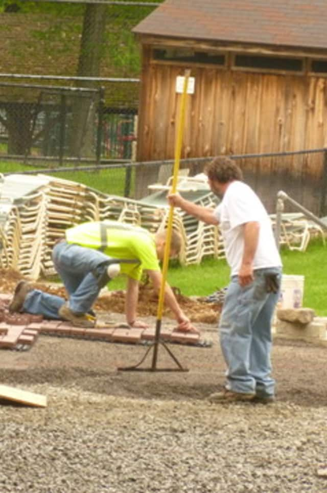 Construction crews work on the renovation of the Pound Ridge pool house.