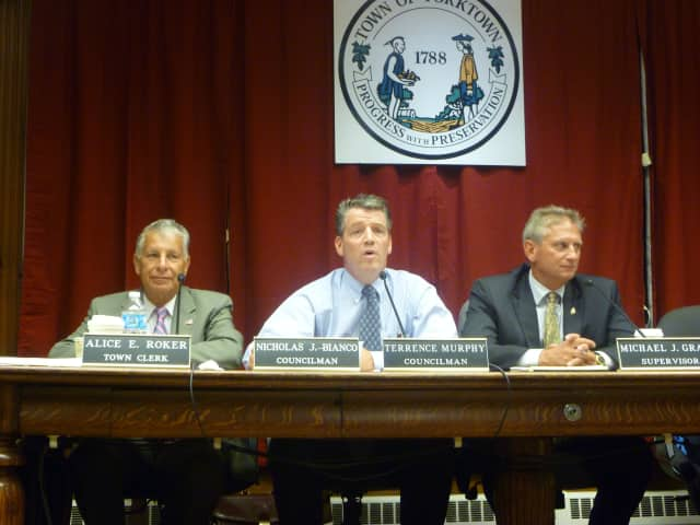 From left: Town board members Nick Bianco, Terrence Murphy and Town Supervisor Michael Grace defended its 2013 budget saying it lowers residents' bills and keeps the town in good shape for 2014.
