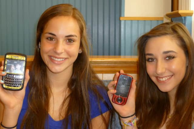 Fox Lane juniors Briannae Hallock, left, and Sara White can't wait for cell service to come to Scotts Corner.