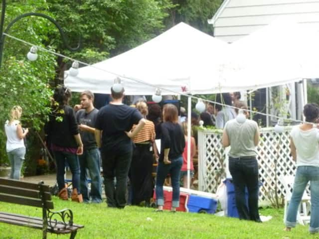 "Film crew works on a scene for ""A Birder's Guide to Everything"" on Aug. 14 at 43 Old Mill Road in Chappaqua"