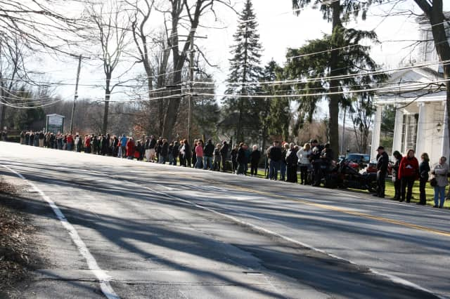 Crowds line Somers' Route 100 on Thursday morning to pay respects to Newtown shooting victim Anne Marie Murphy.