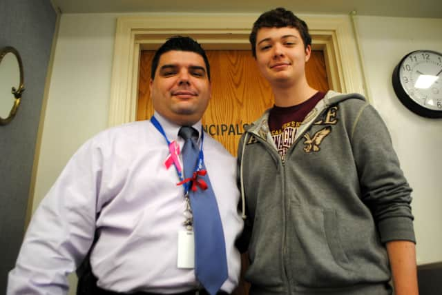Hen Hud senior Kevin Kiley, right, has won recognition for his achievement in Italian language studies. At left is James Mackin, principal of Hendrick Hudson High School.