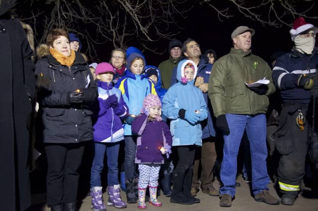 Members of the Mamaroneck community bear the cold Friday to remember victims of the Sandy Hook Elementary School shooting.