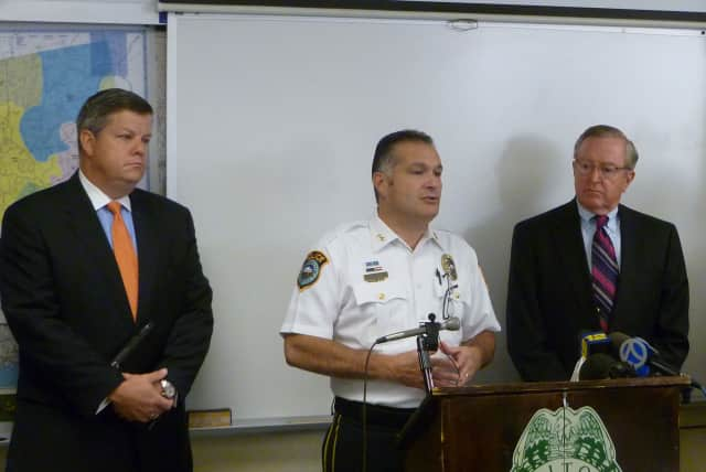 Wilton Police Chief Michael Lombardo, left, speaks during an August press conference to announce the arrest of a juvenile in connection with the 2008 death of 13-year-old Nicholas Parisot.
