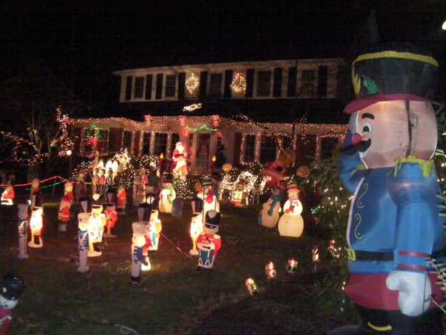 Residents adorn their lawn with Christmas lights and decorations.
