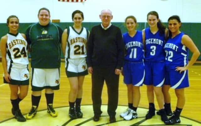 John Costello, center, last year hosted the holiday tournament named in his honor.