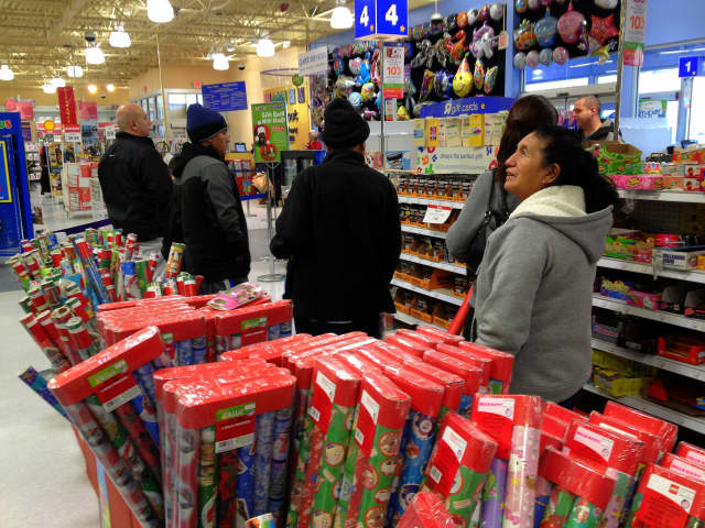 "Shoppers at Toys ""R"" Us, which is closing about one-fifth of its stores across the nation."