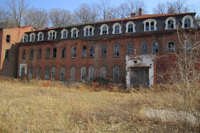 The abandoned Brandreth Pill Factory in Ossining is the source of a dispute between developers and the town.