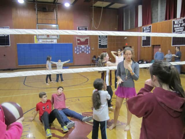"""St. Theresa School alumnus Tara Hammonds, 16, organizes a volleyball game with community members and kids during """"Occupy St. Theresa"""" Saturday night."""