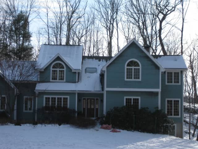 This Millwood home, located at 37 Shinglehouse Roadd, caught fire Sunday night due to a faulty fireplace.