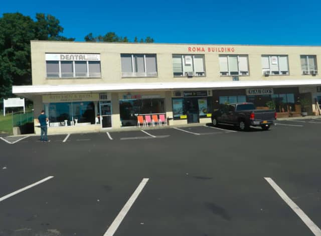 A hole in the parking lot of the Roma Building in Yorktown Heights should be filled in within the next two to three months, the Town Board was told recently.