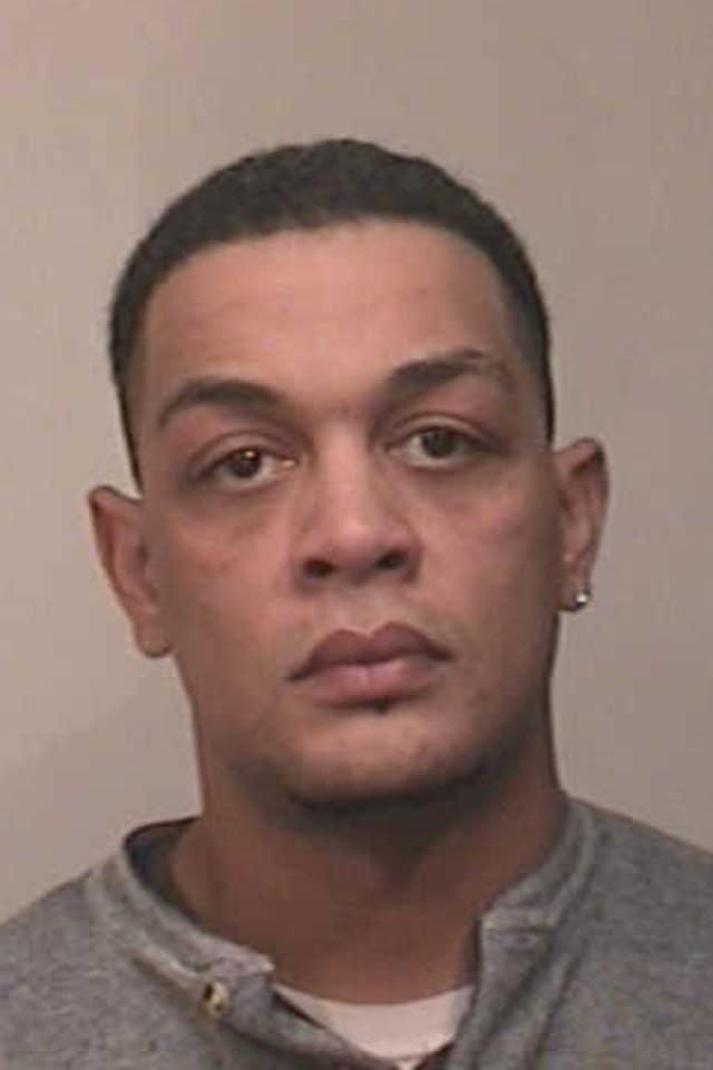 Jewol Warkoski, 35, of New Britain was charged with sixth-degree larceny.