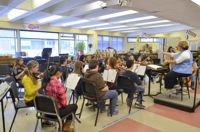 The Fox Lane Middle School Sinfonetta Orchestra rehearses for its performance at the American String Teachers Association National Conference next month in Rhode Island.