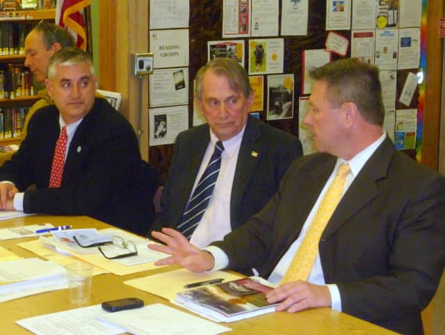 Members of the Lewisboro Town Board discuss committee appointments at its organizational meeting. From left, Dan Welsh, Peter DeLucia, Supervisor Peter Parsons, and Frank Kelly