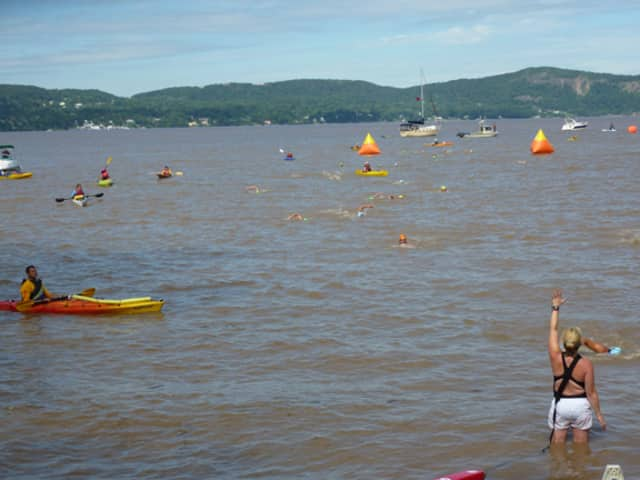 """Ossining's Riverkeeper recently released a report on sewage found in the Hudson River. Swimmers and kayakers at the finish of the """"Swim for Life"""" swim across the Hudson River in this submitted photo."""