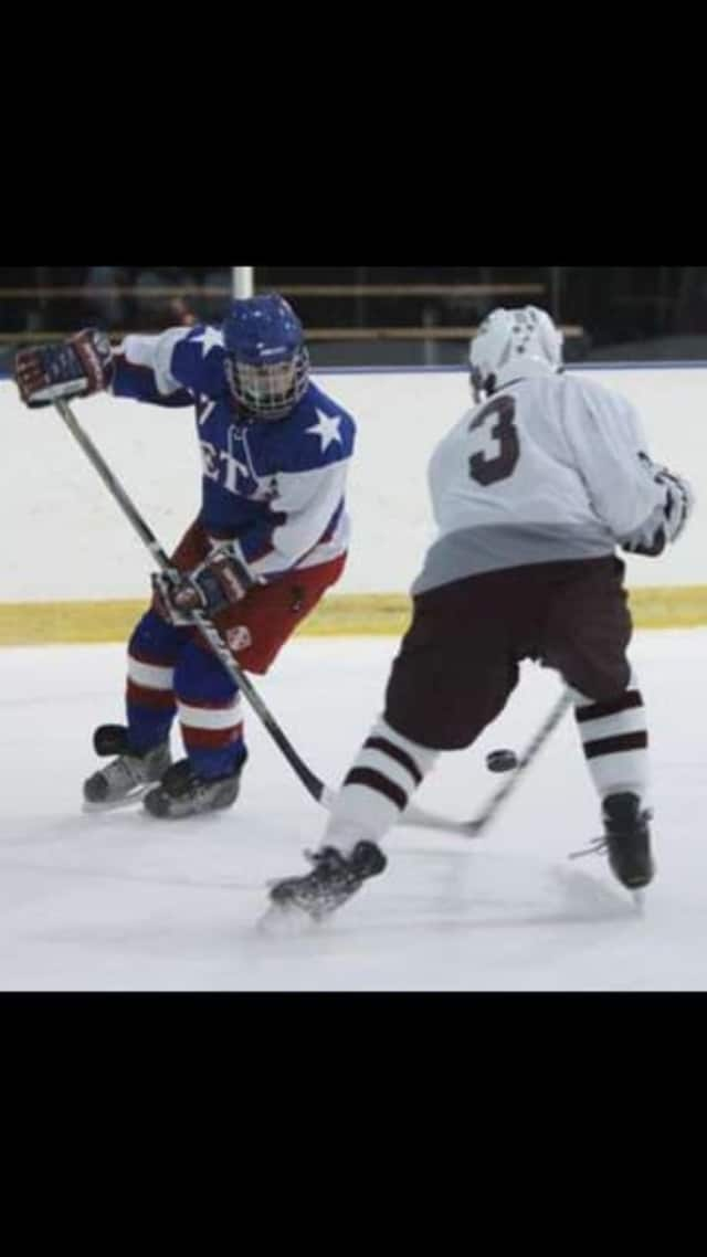 Hockey player Chris Hagen, in blue, was selected the Bronxville Daily Voice December Athlete of the Month.