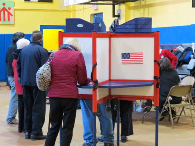 A Port Chester voter casting a ballot at the Don Bosco Center. Three Democrats and three Republicans were elected to the village's Board of Trustees on Tuesday.