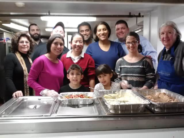 Employees of Axon Communications volunteered at a Mount Vernon soup kitchen on Thursday night.