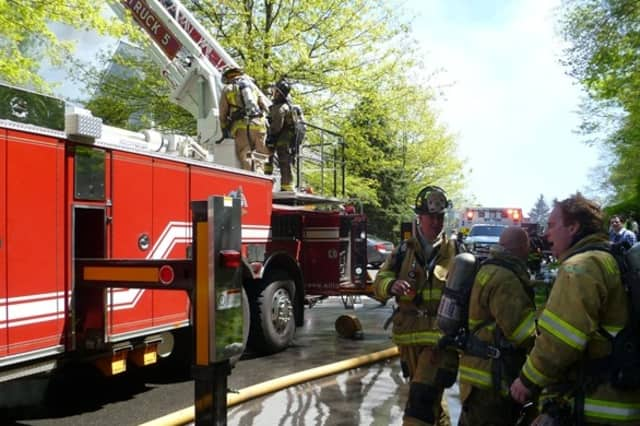 Wilton firefighters at work at a fire last year at Wilton Crest.