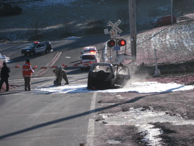 A white SUV on Roaring Brook Road just off of the Saw Mill River Parkway was involved in a fire Thursday morning.