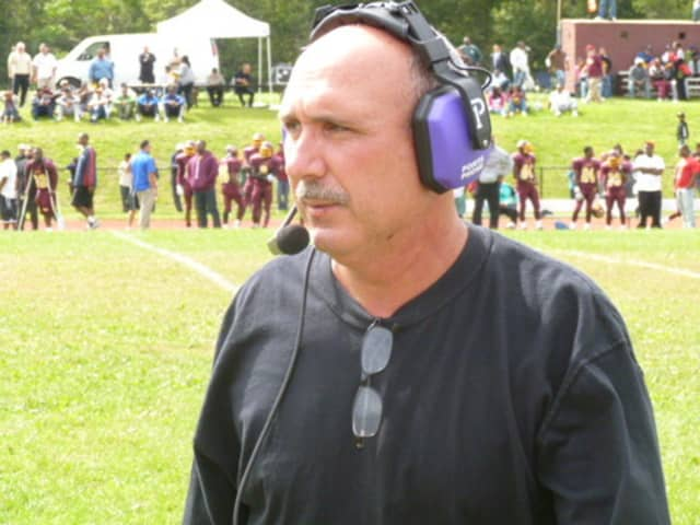 New Rochelle football coach Lou DiRienzo will not face criminal charges as the investigation continues.