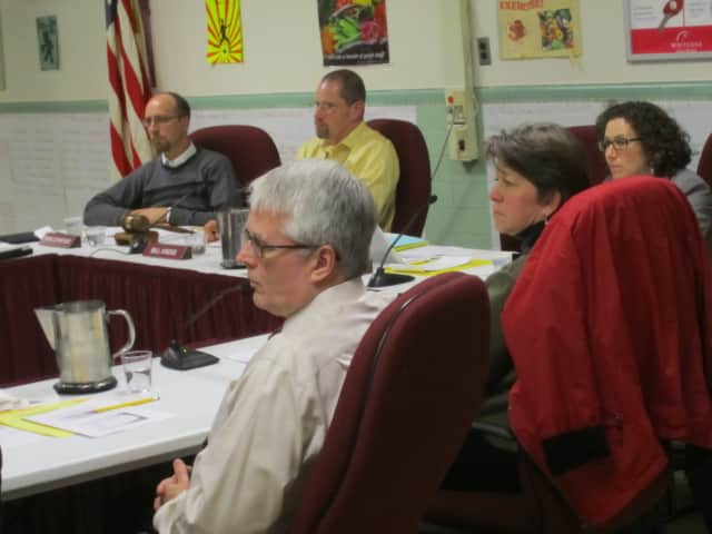 Ossining school board members listen to the public at a mini budget session Jan. 16. With the sessions concluded, the board will need to consider budget cuts.
