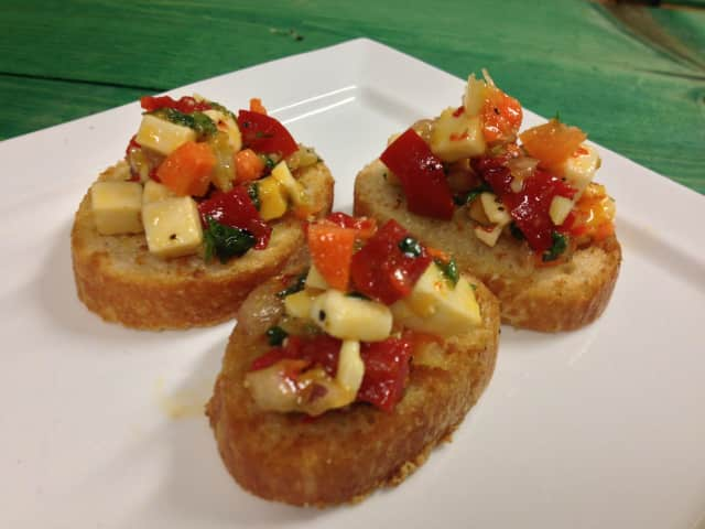 A provolone salad on crostini appetizer is an easy and more healthful alternative to traditional Super Bowl Sunday fare.