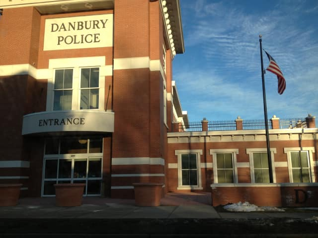 A New Fairfield man was charged with DUI following a car fire in Danbury.