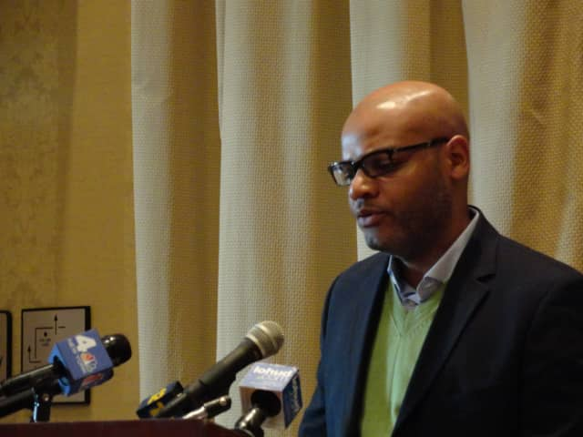 Danroy Henry Sr. speaks with members of the media last week at a press conference in Tarrytown.