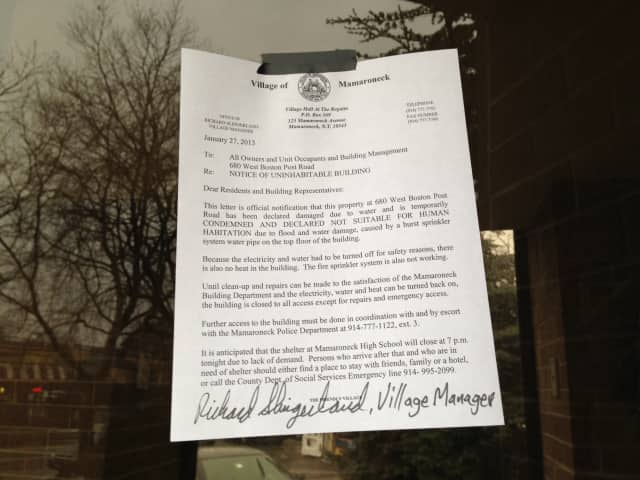 A notice posted at the entrance of 680 W. Boston Post Road in Mamaroneck says the building is uninhabitable.