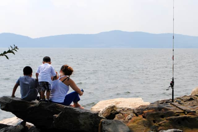 A family fishing along the Hudson River in Croton, where signs warning about the dangers of eating fish from the river could soon be placed.