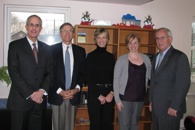 Representatives of Berchem, Moses & Devlin meet with Homes With Hope CEO and President Jeff Wieser, second left. See story for photo identification.