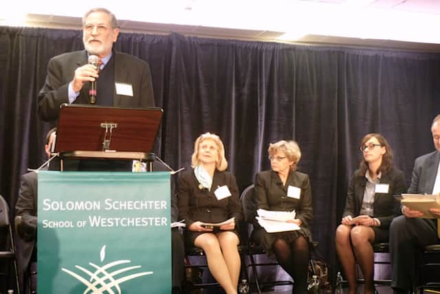 Elliot Spiegel, head of the Solomon Schechter School of Westchester, introduces six New York state legislators Thursday in Hartsdale at forum discussing affordability of private school tuition.