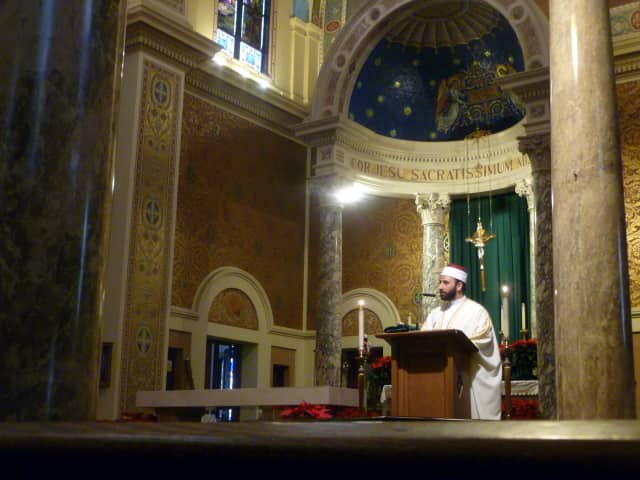 Shaikh Waleed Elbatrawish of the Imam Andalusia Islamic Center recites a prayer Sunday at the Interreligious Prayer Service at the Monastery Church of the Sacred Heart in Yonkers.