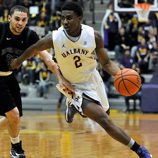 White Plains resident Reece Williams, right, playing for the University of Albany.